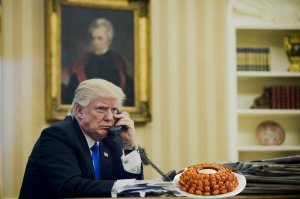 U.S. President Donald Trump speaks on the phone with Malcolm Turnbull, Australia's prime minister, during the first official phone talks in the Oval Office of the White House in Washington, D.C., U.S., on Saturday, Jan. 28, 2017. Turnbull is confident the new U.S. administration will uphold an agreement to resettle asylum seekers held on Pacific island camps. Photographer: Pete Marovich/Pool via Bloomberg